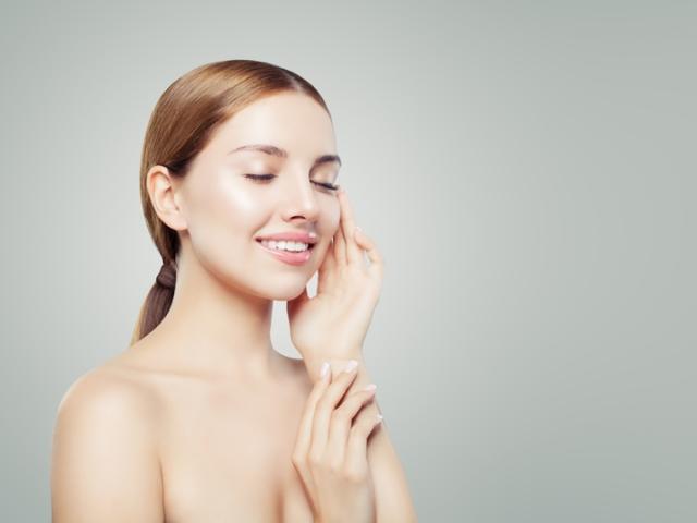 Calm girl having spa facial massage
