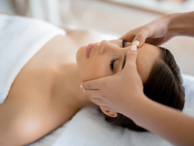 Calm girl having spa facial massage