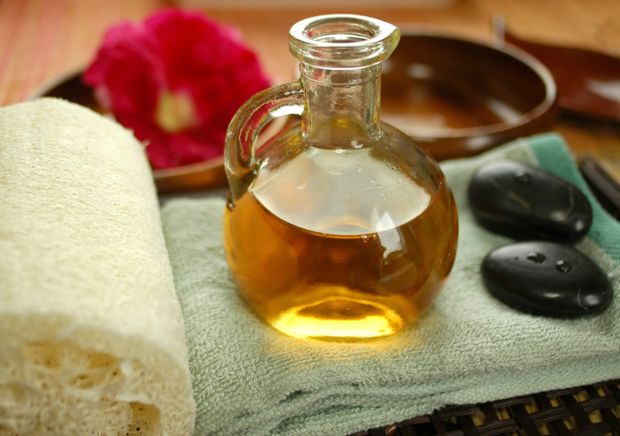 Alternative therapy with warm massage oil.