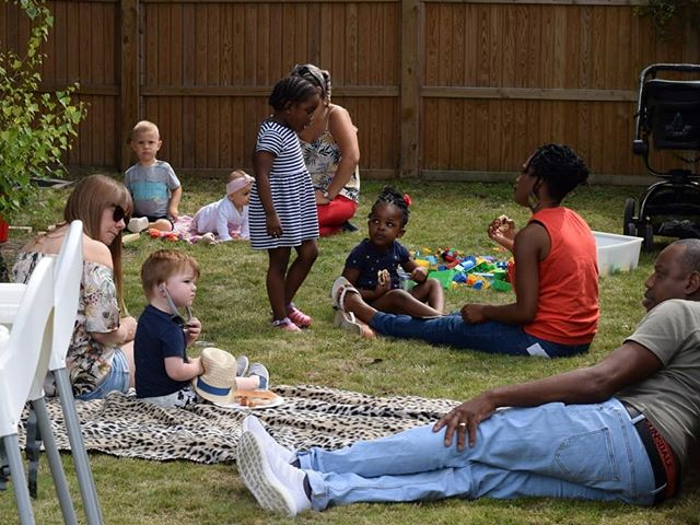 Children & Parents At Nursery Making Friends