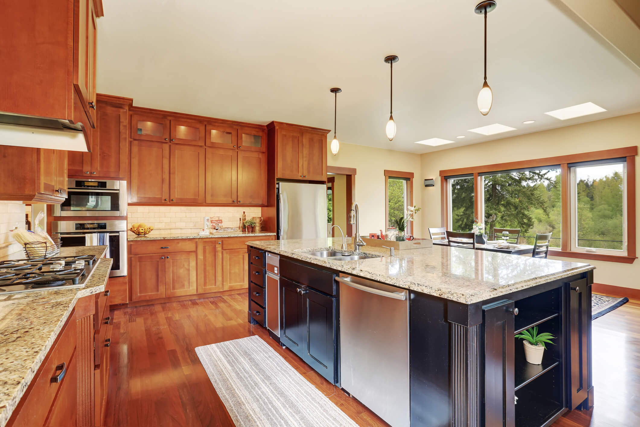 Kitchen area with open floor plan, view of dining room.