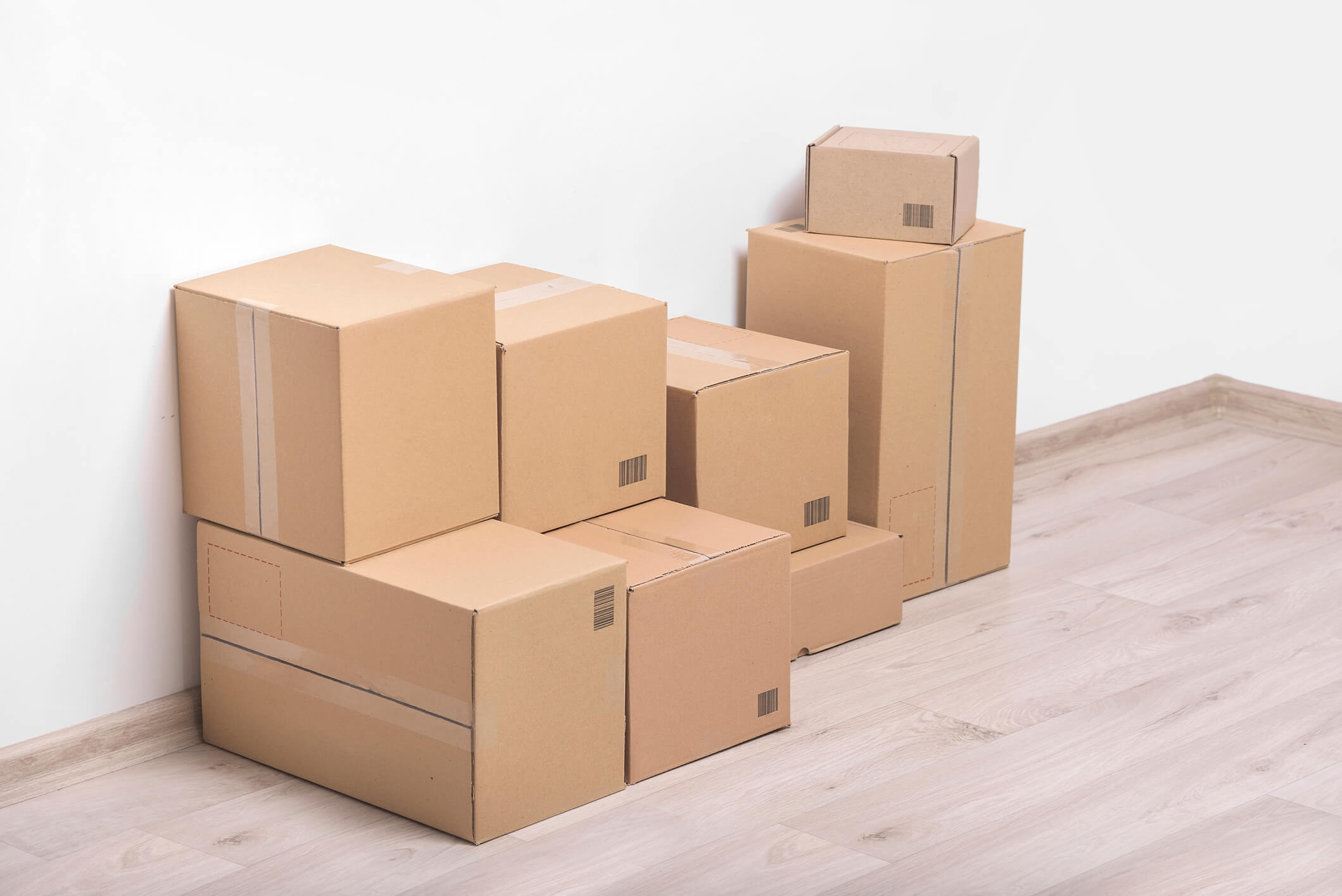 packed cardboard boxes sat in an empty room
