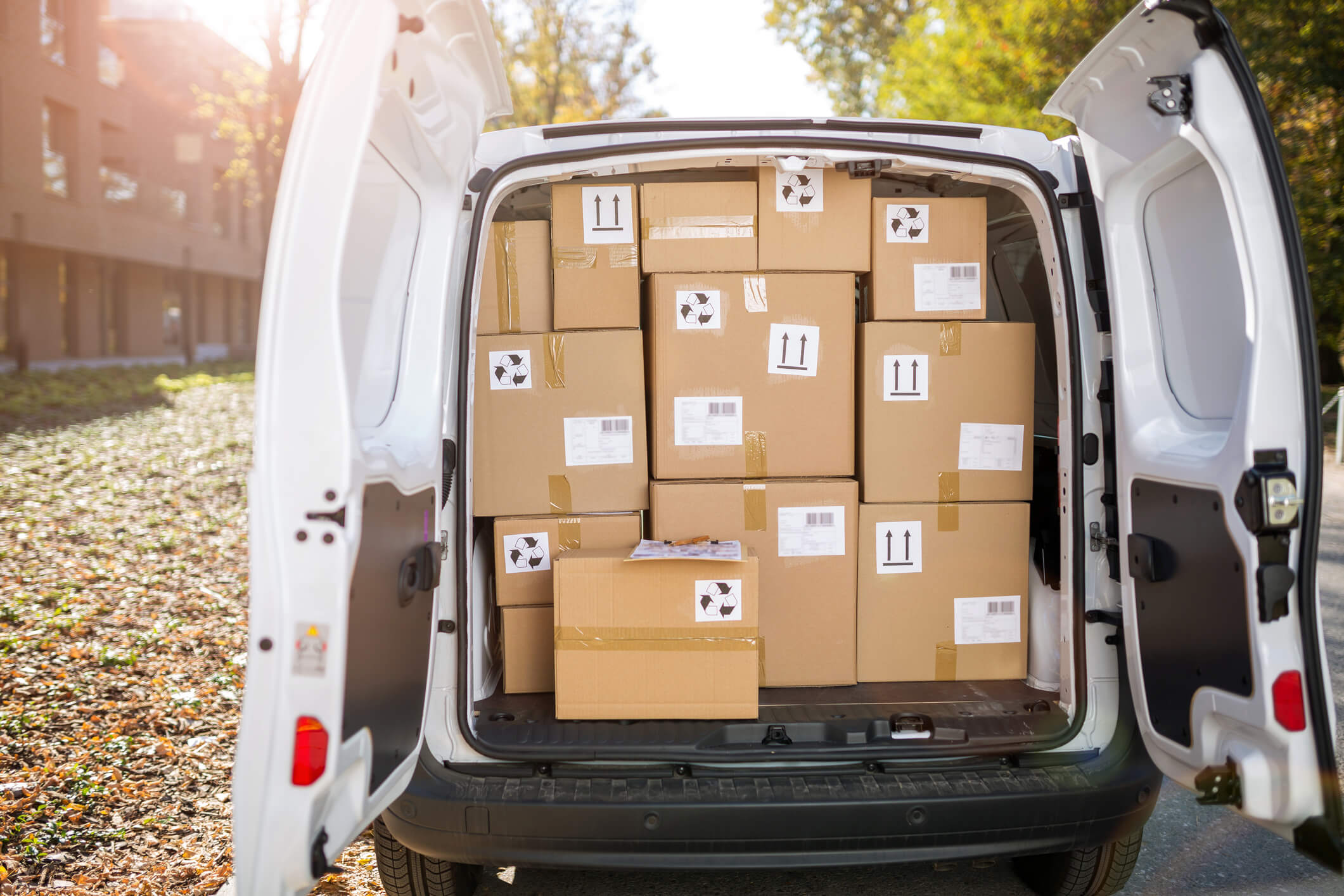 packed cardboard boxes sat in a courier van