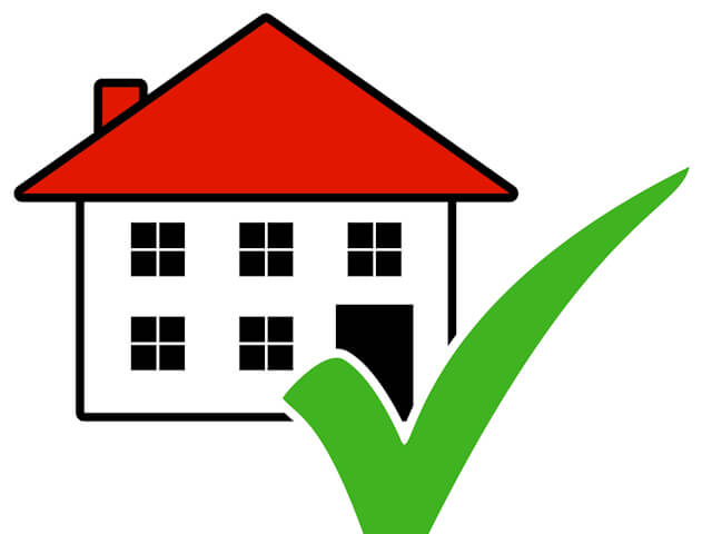 Isolated Icon of House with green tick