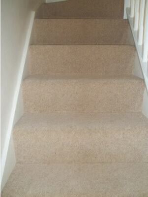 Newly carpetted ascending stairs