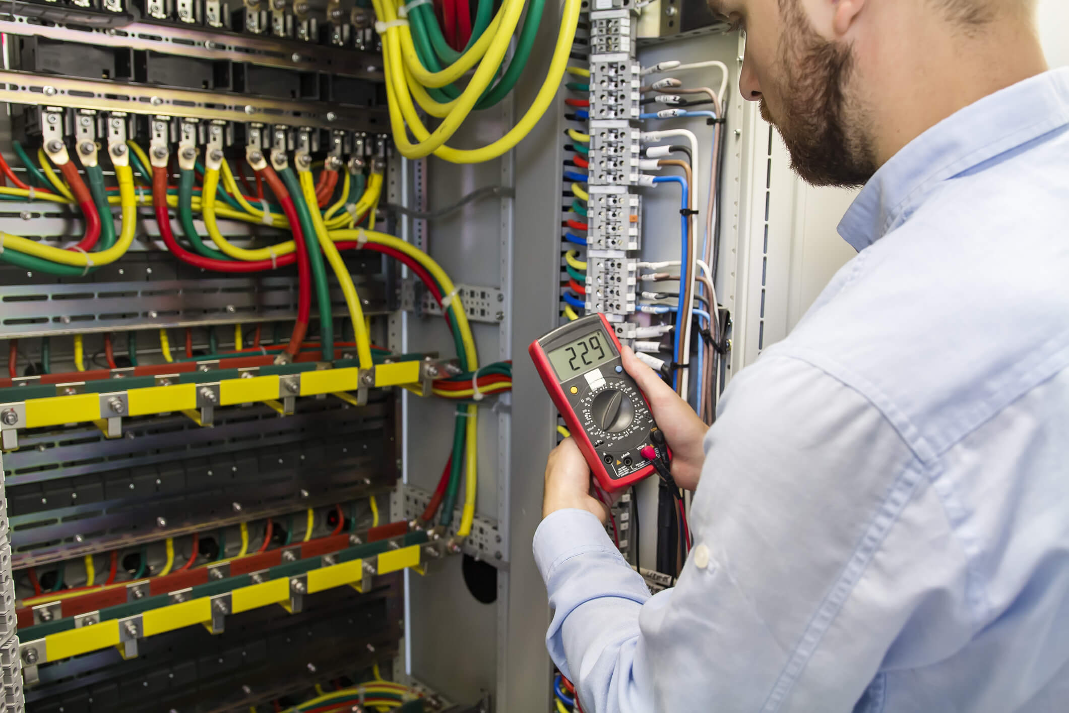 lectrician engineer testing cabling connection of high voltage power electric line.
