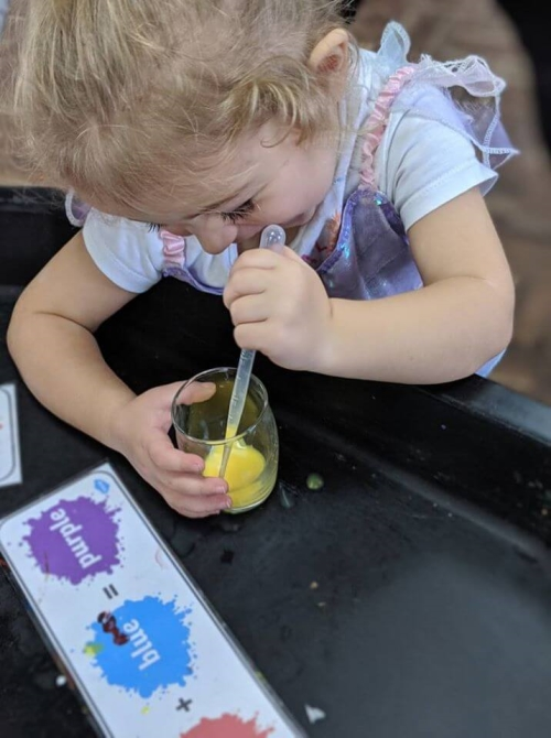 Kid mixing colours