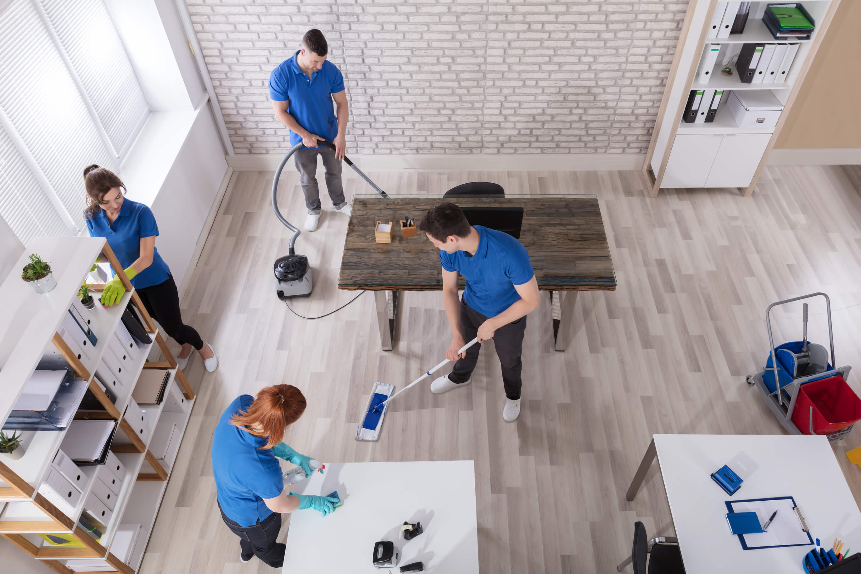 Janitors cleaning an office.