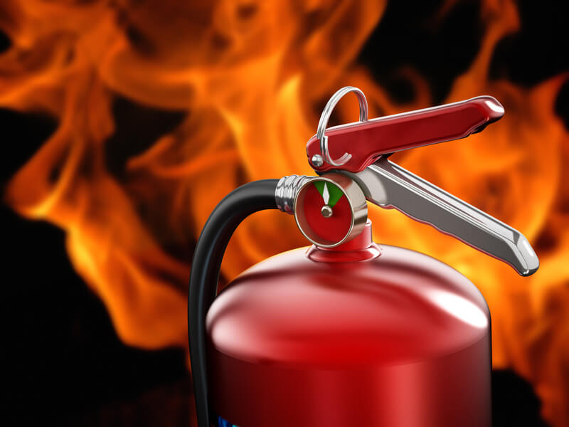 Fire extinguisher on flame background