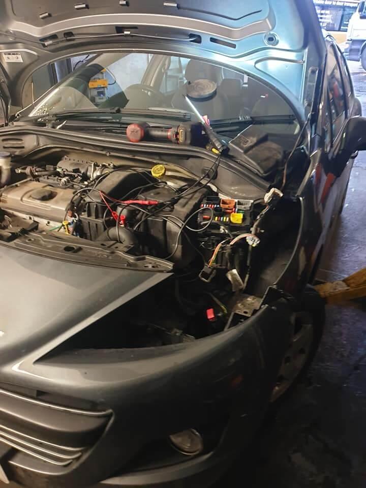 Corsa having its electrics repaired