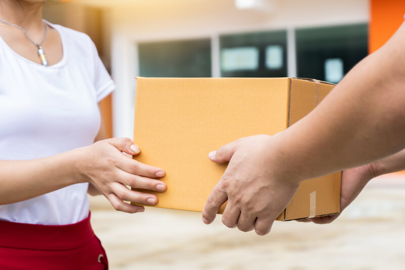 Woman taking parcel from storage