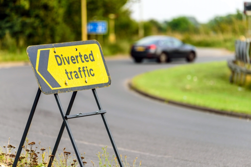 Diverted Traffic sign on a roundabout.