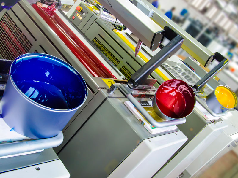 printing machines with buckets of colour placed on top