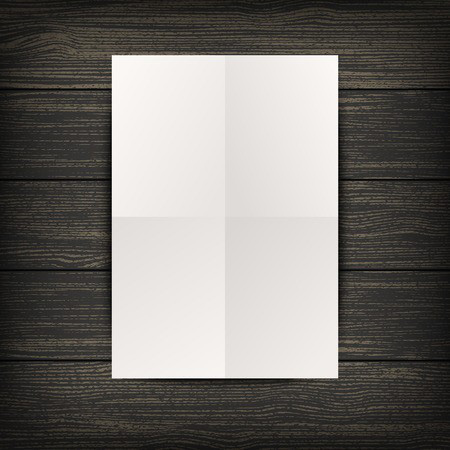 paper on a black wood background