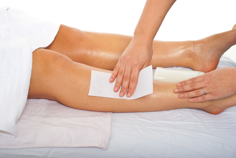 Professional waxing on a womens legs.