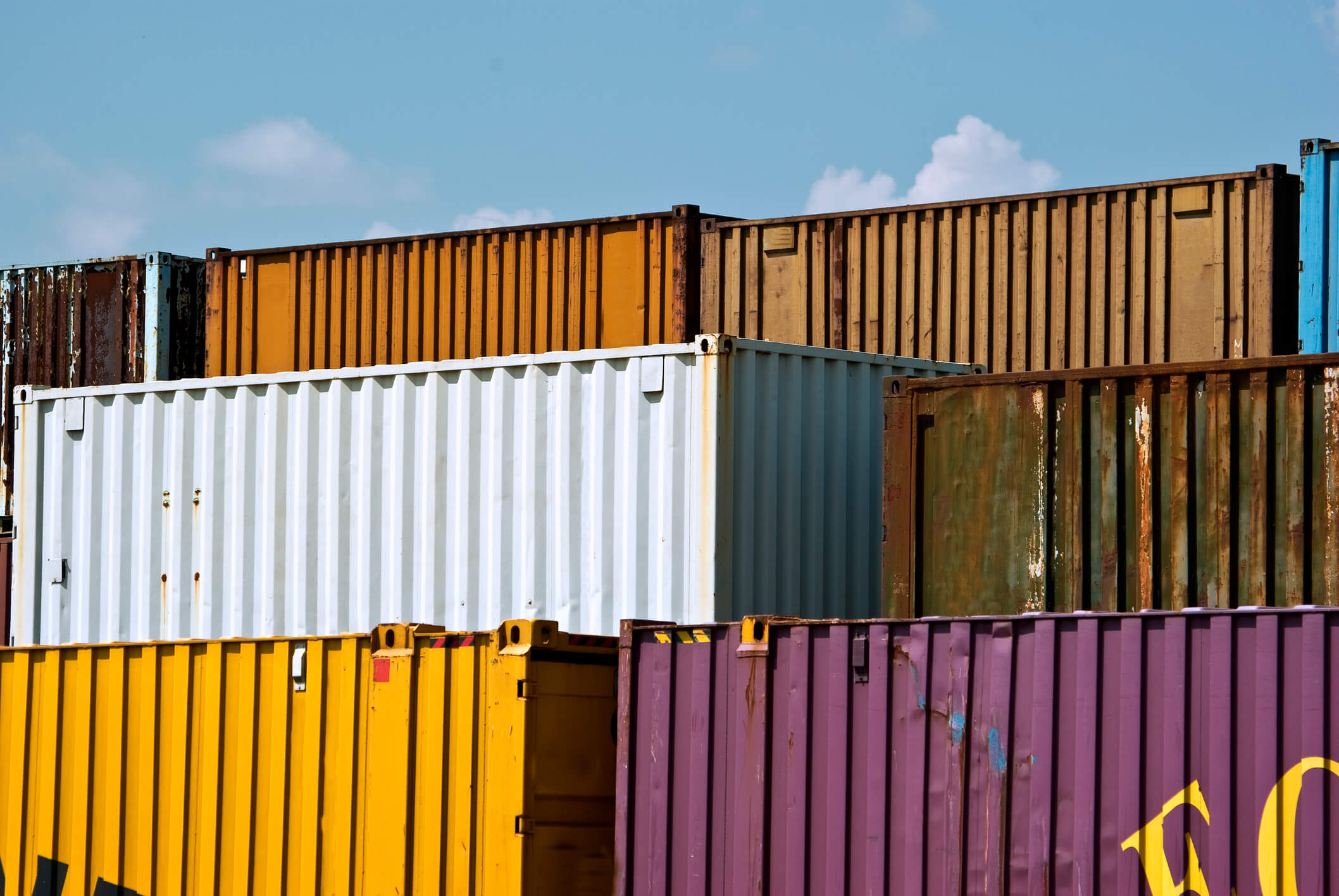 Freight containers stacked in various colors for shipping