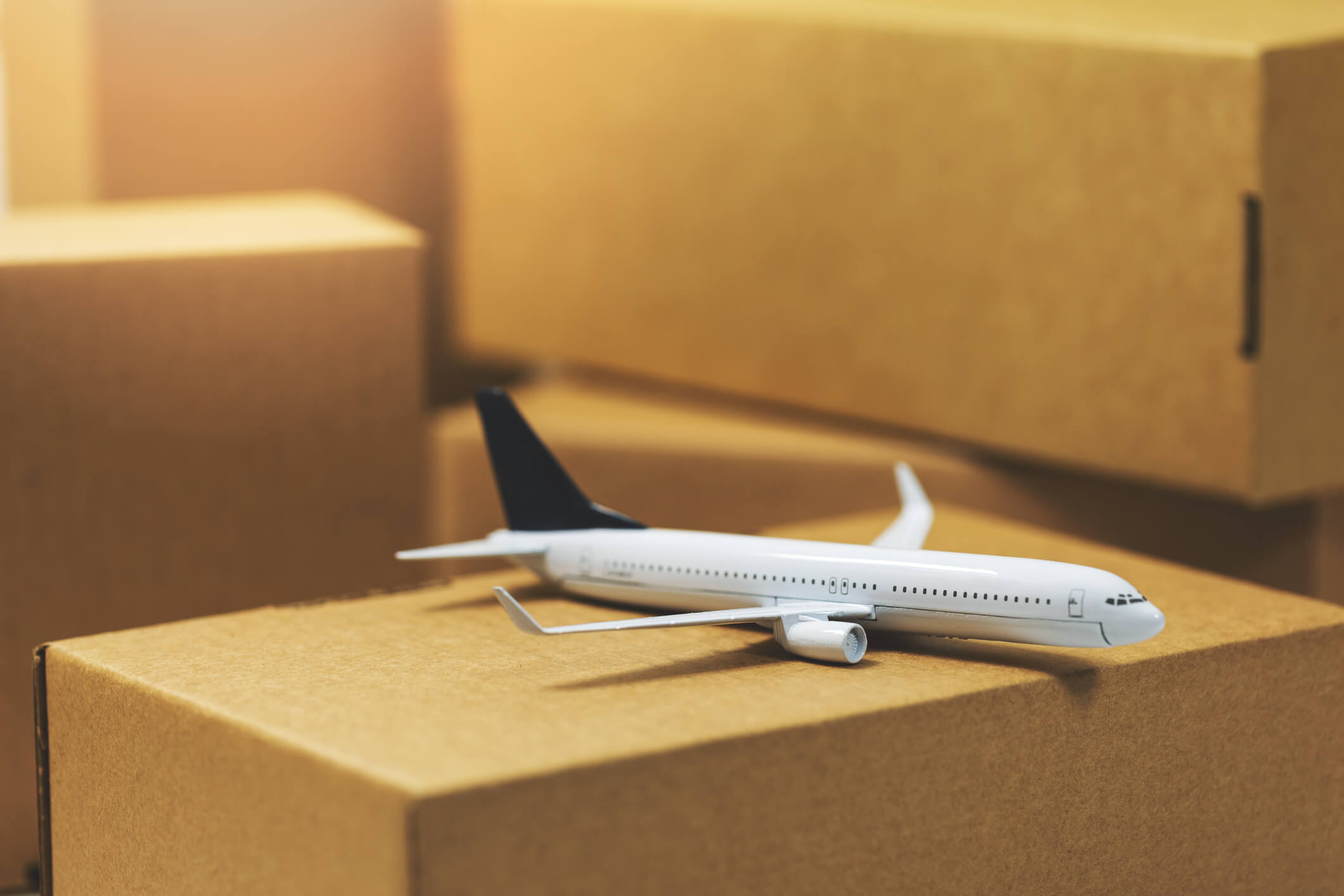 Air Freight concept, toy plane on cardboard boxes.