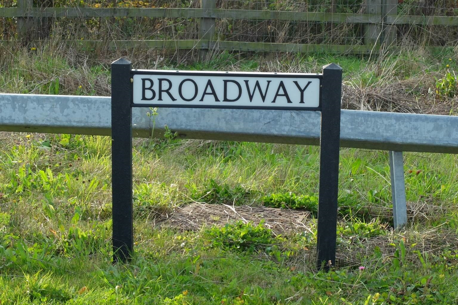 Broadway road sign on the side of the road.