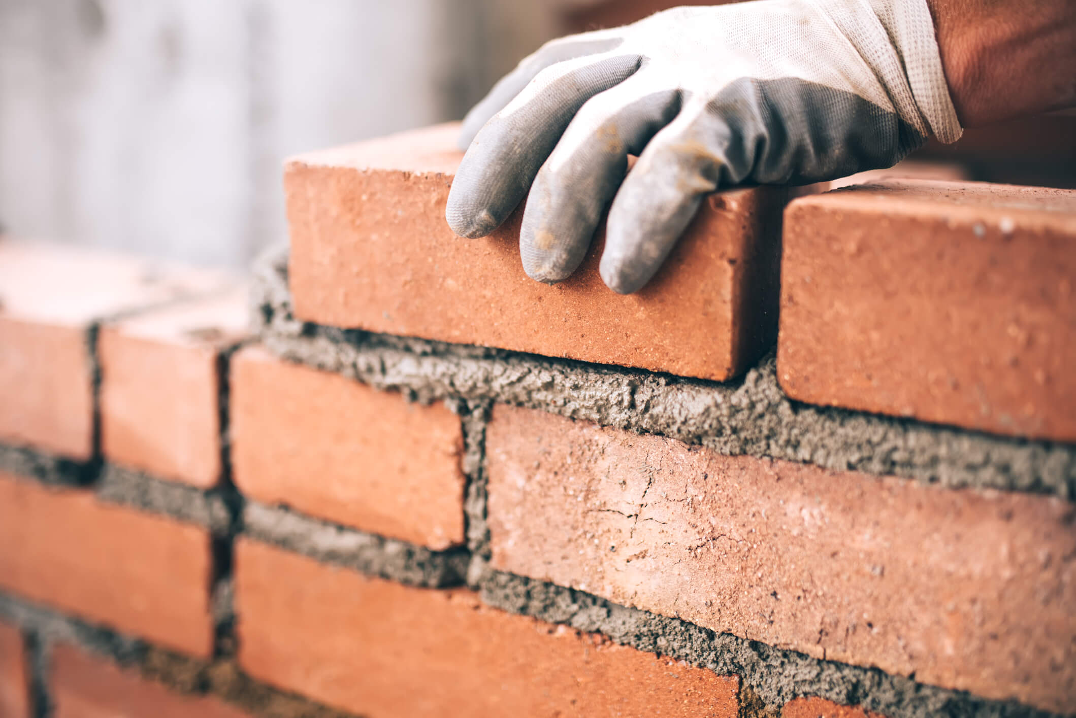 Man making a brick wall.