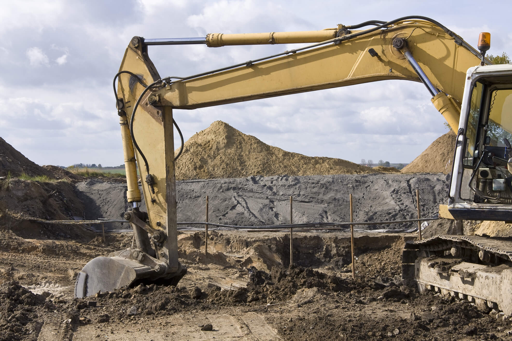 Large machine excavating dirt.