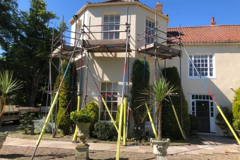 scaffolding around a house