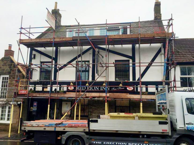 Erected scaffolding around commercial building