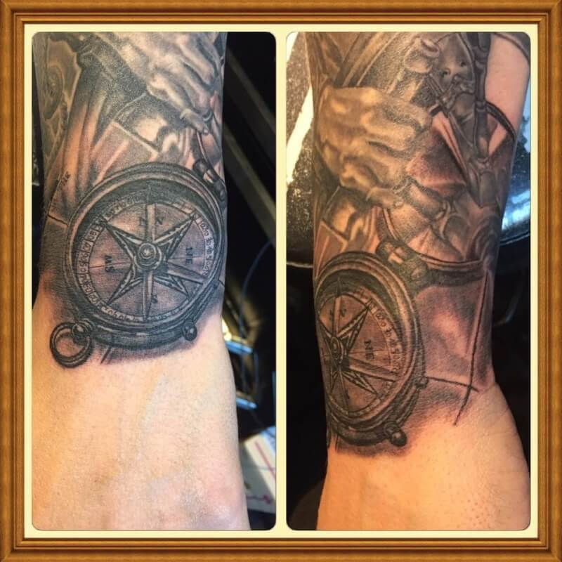 Tattoo of a compass on an arm.