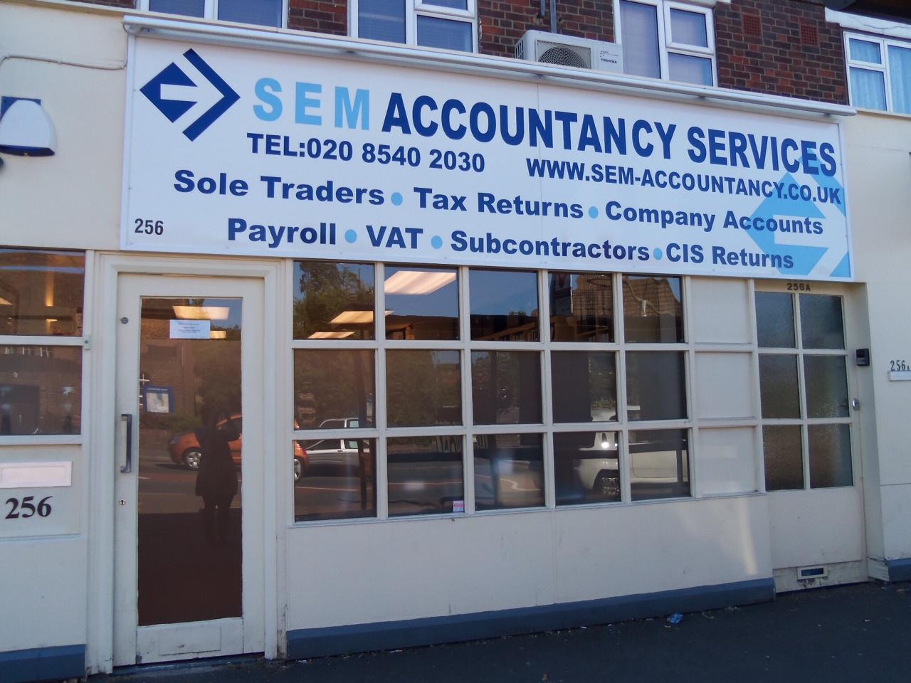 Two accountants working on accounts.