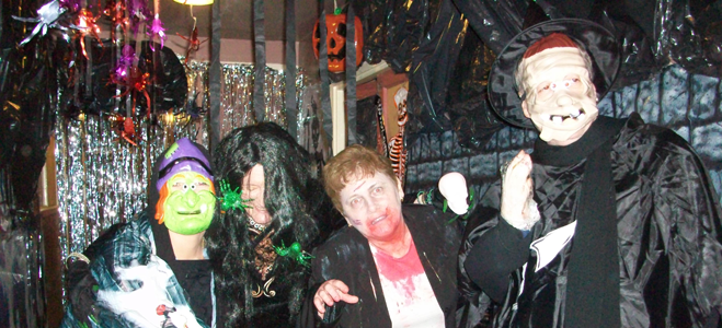 A group of people dressed for halloween.