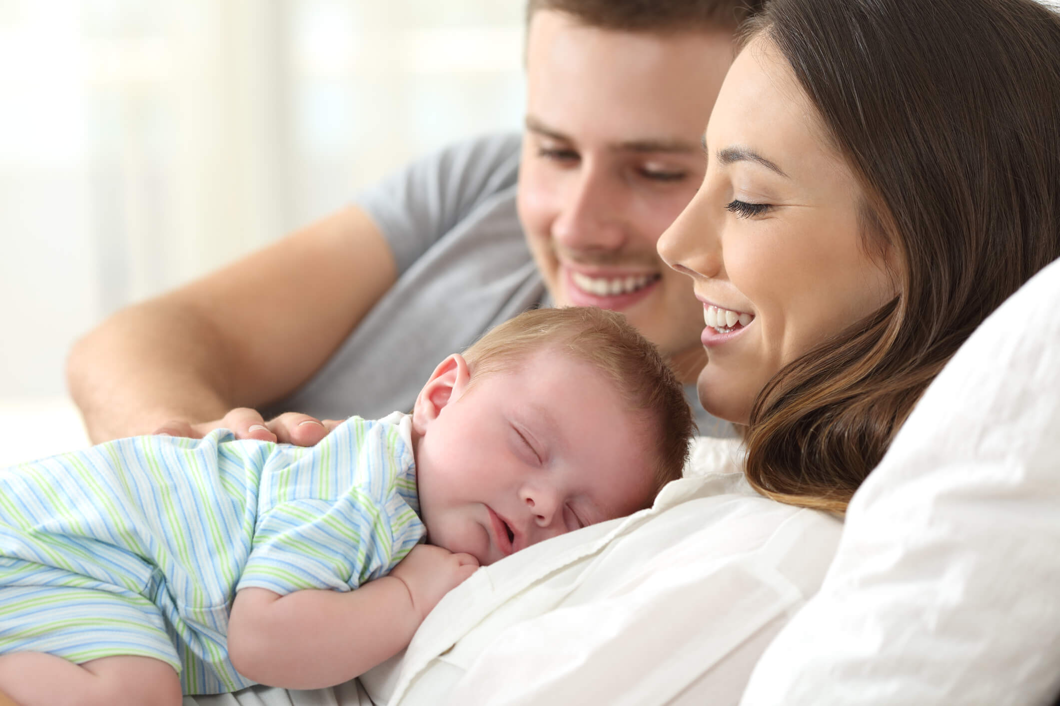 New parents with their baby.