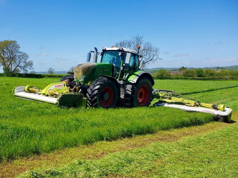 Tractor mowing field