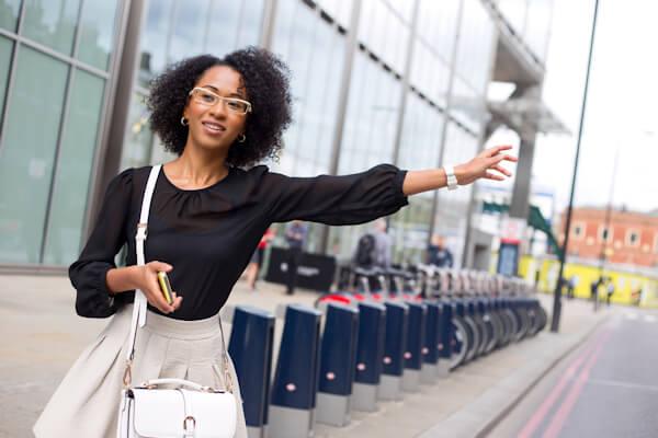 Girl signalling a taxi