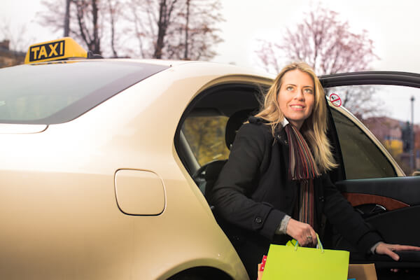 Woman with Shopping in Taxi