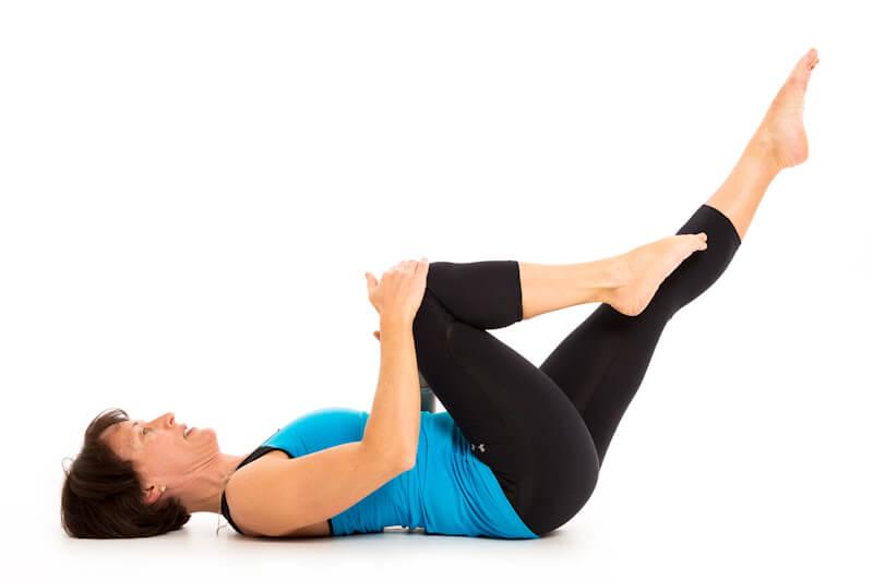 Tessa doing Pilates on yoga mat