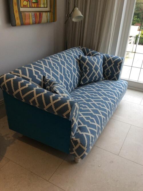 Re-upholstered blue sofa