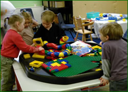 Children building lego