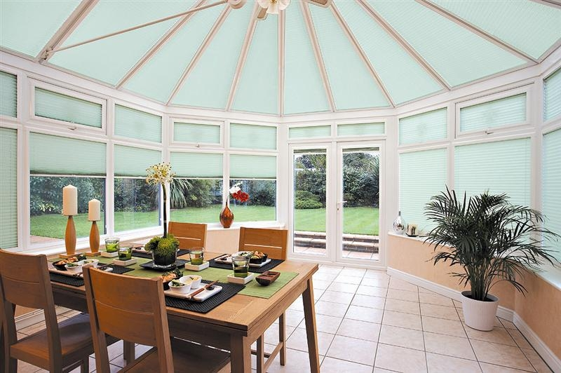 A bright conservatory with dining equipment