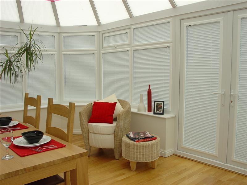A white conservatory with closed blinds