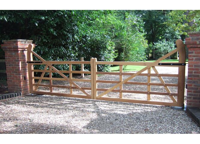 Bespoke wooden gate on drive way