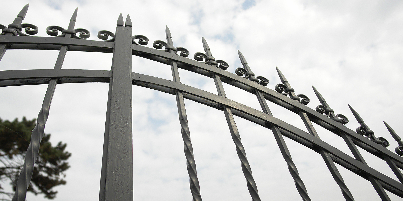 Iron Gate Against Overcast Sky All Pages