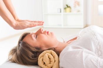 Woman experiencing reiki healing