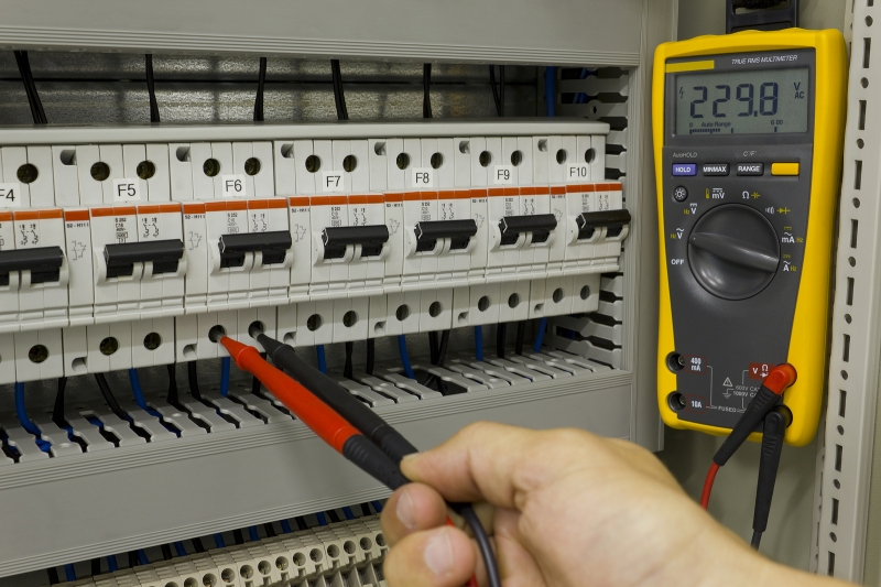 An Electrician with a Multimeter