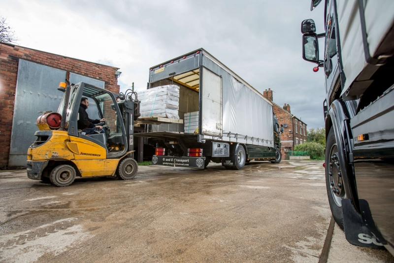 Lorry being loaded with forklift truck ready for transportation