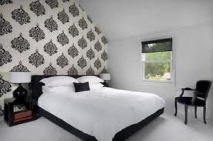 Stylish modern bedroom with feature wall