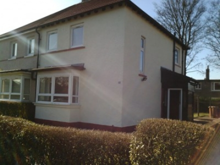 Semi detached house with freshly painted pebble-dash walls