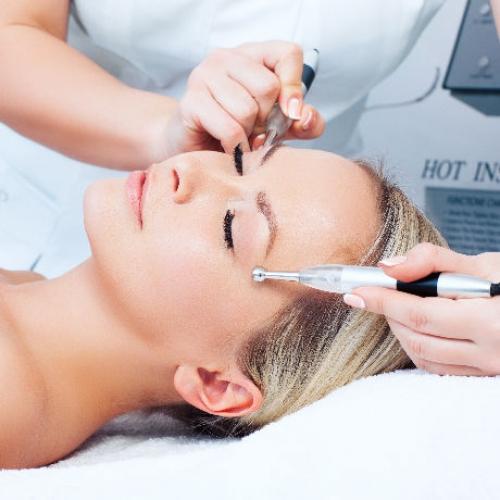 woman laying down getting dermalift treatment