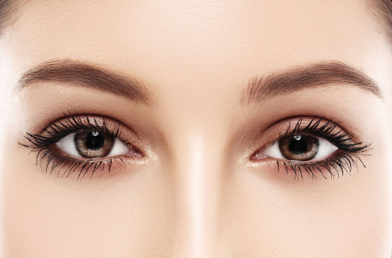 woman with brown eyes and eyebrow tint looking at you