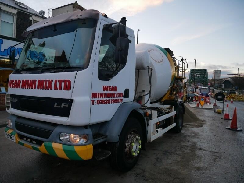 Wear mini mix Ltd Mix truck delivering screed