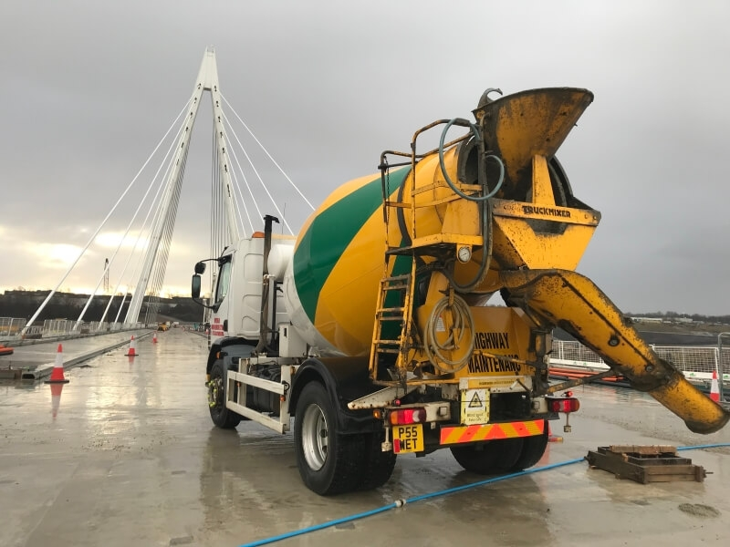 Wear Mini Mix Ltd Mixer truck on bridge with new concrete surface