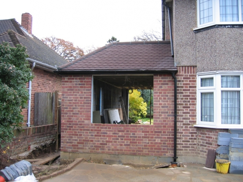 property with side extension being built underway